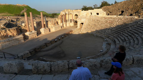 Panning shot of Time lapse of tour groups in an ancient Roman amphitheater Footage