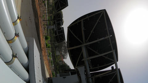 Vertical shot of Time-lapse shot behind an array of solar collectors tracking th Footage