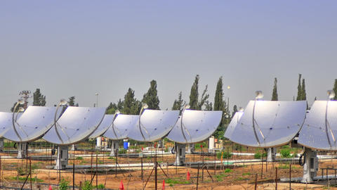 Time-lapse shot of solar collectors tracking the movement of the sun. Cropped Footage