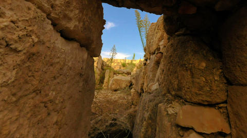 Time-lapse moving through a door in ancient ruins. Cropped Footage