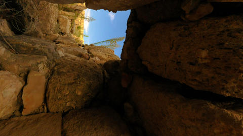 Vertical shot of Time-lapse moving through a door in ancient ruins Footage