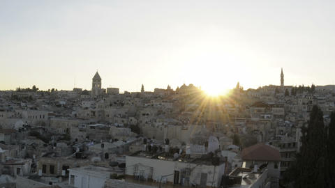 Time lapse of night falling over Jerusalem rooftops. Cropped Footage