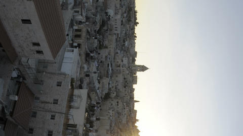Vertical shot of Time lapse of night falling over Jerusalem rooftops Footage