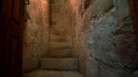 Stock Footage of a narrow stone spiral staircase in Israel Live Action