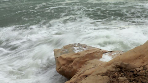 Stock Footage of waves crashing against a rocky shore in Israel Footage