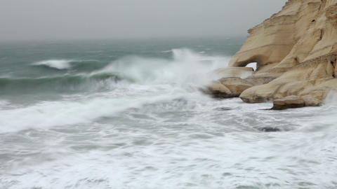Stock Footage of waves splashing against a rocky shore in Israel Footage