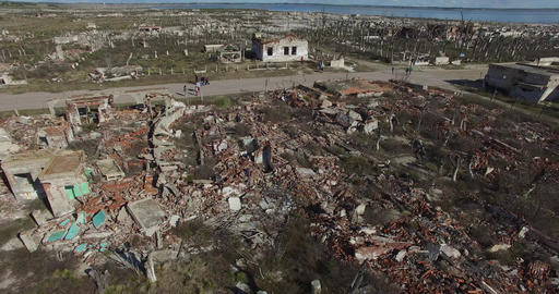 Aerial drone scene of abandoned, destructed town. Demolished, old, rubbled house Footage