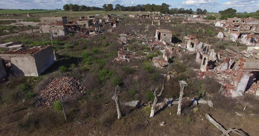 Aerial drone scene of demolished, destroyed city. Camera moves to the side panni Footage