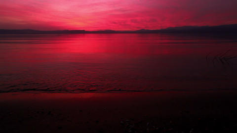 Stock Footage of a vibrant red sunset at the Sea of Galilee in Israel Footage