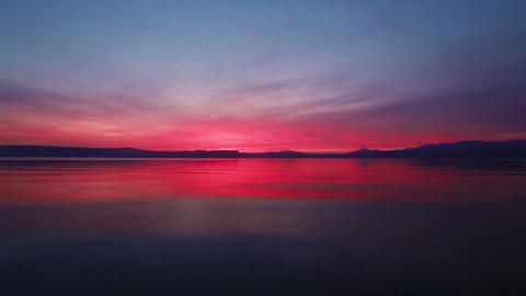 Stock Footage of the colorful sky reflected in the Sea of Galilee in Israel Footage