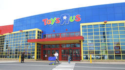 People entering Toys R US store with closing, bankruptcy sale promotion sign Footage