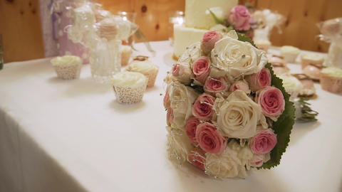 Beautiful bouquet of roses on the wedding table in a luxury restaurant Footage