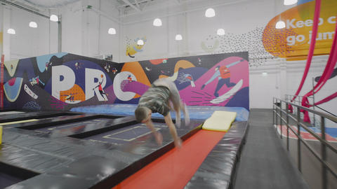 Sportsman doing acrobatic trick and fall down Footage