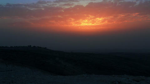 Stock Footage of an orange, cloudy sunset in Israel Footage