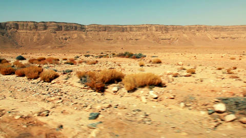 Stock Footage drive-by of the Makhtesh Ramon desert floor in Israel Live Action