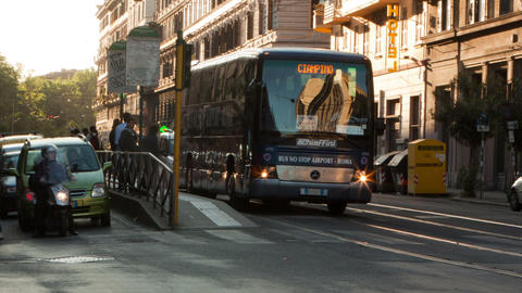 Panning time-lapse of a busy street and city trolley stop in Rome Footage