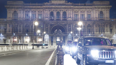 Panning time-lapse of shot of the Palace of Justice from the bridge at night Footage