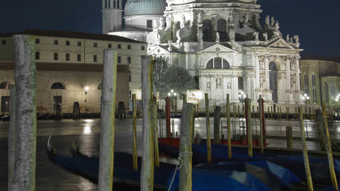 Panning time-lapse of at night of Santa Maria della Salute from Saint Mark's Squ Footage