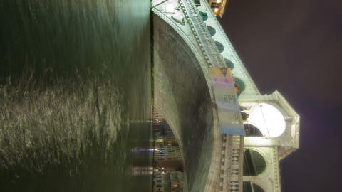 Vertical shot of Rialto bridge time-lapse from side of canal Footage
