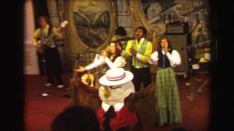1970: Busch Gardens mascot leading singing performance group ending song Footage