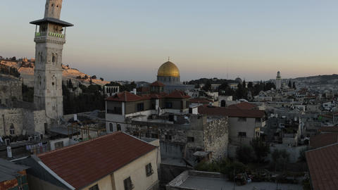 Tracking time-lapse of Jerusalem and the Dome of the Rock at dusk. Cropped Footage
