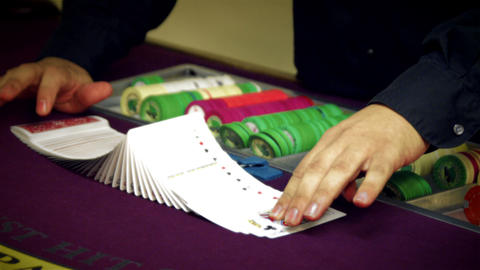 Preparing cards to shuffle onto casino table Footage