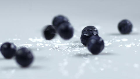 Blueberries dropping onto a table Footage