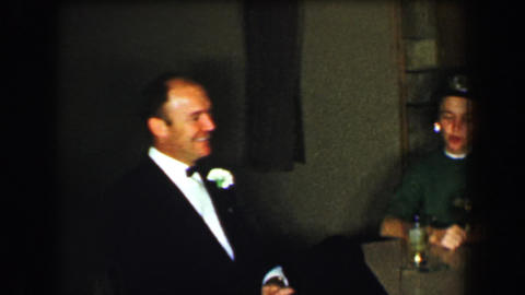 1958: Adults enjoying cigarettes cocktails after formal wedding event Footage