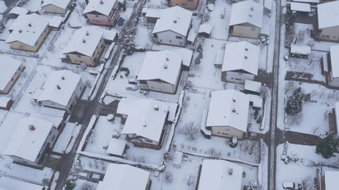 Aerial - Flight over snowy houses in winter season Footage