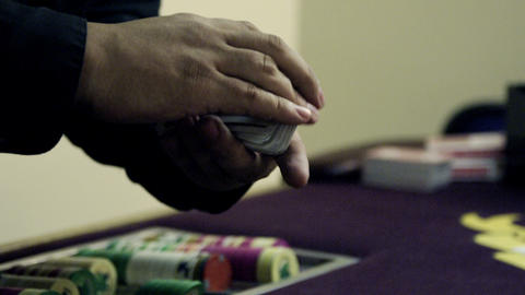 Dealer shuffling and fanning cards Footage