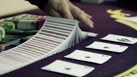 Dealer shuffling and splitting the deck Footage