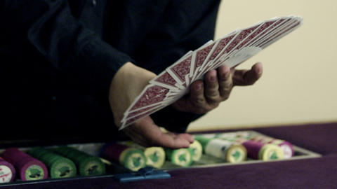 Dealer fanning and showing deck of cards Footage