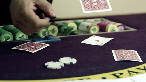 Twirling a poker chip through fingers Footage