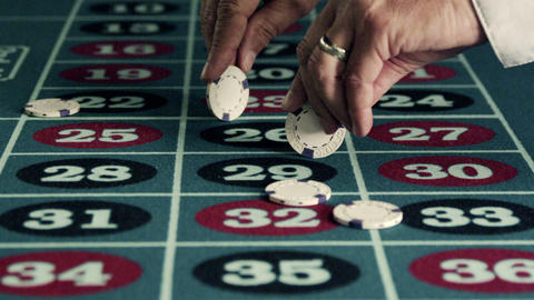 Spinning chips on a roulette table Stock Video Footage