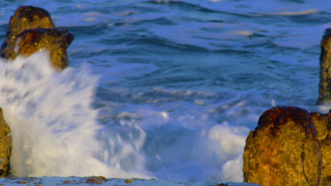 Stock Video Footage of waves over a ruined pier on the Mediterranean shot in Isr Footage