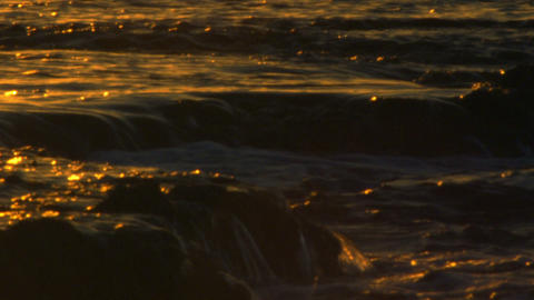 Stock Video Footage of waves breaking at sunset at Dor Beach shot in Israel at 4 Footage