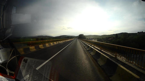 Image seen through the windscreen of a bus that travels fast on a road with two Footage
