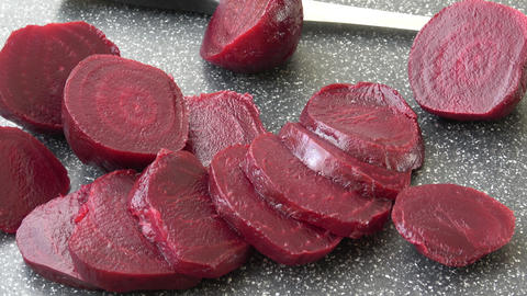 Beetroot (beet) chopped for salad. Healthy ingredient for cooking. Cooked beet Live Action
