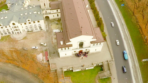 Newlyweds gather near the Catholic Church with a bird's-eye view in the fall Footage