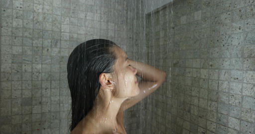 Asian woman in Shower - woman washing hair showering in luxury bathroom at home Live Action