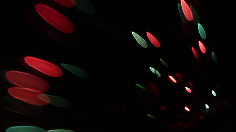 Multicolored disco lights that blink to create a warm…, Live Action