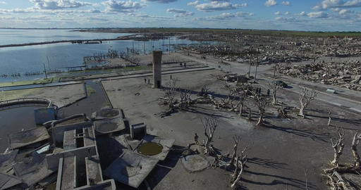 Aerial drone scene of destroyed city by natural catastrophe. Camera flys through Live Action