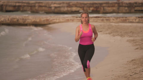 7-Active Girl Doing Fitness Running On Beach GIF