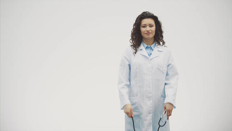 A serious young woman in a Caucasian woman in a laboratory robe looking at you Footage