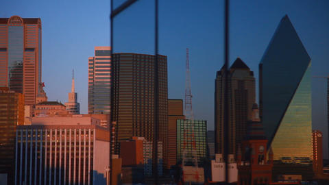 Dallas skyline reflected off a window during sunset Live Action