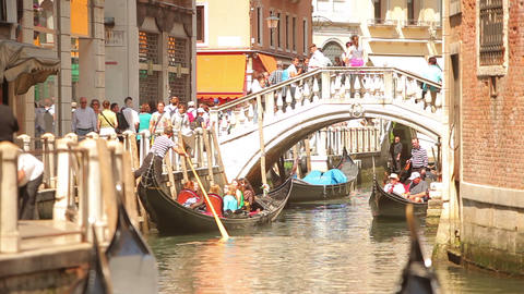 Gondolas pass under a bridge Footage
