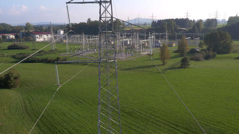 Aerial - Flight between the electrical wires of a pylon Footage