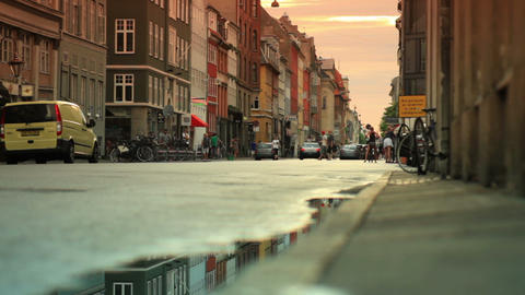 Dolly shot of people and vehicles on a street in Copenhagen, Denmark Footage
