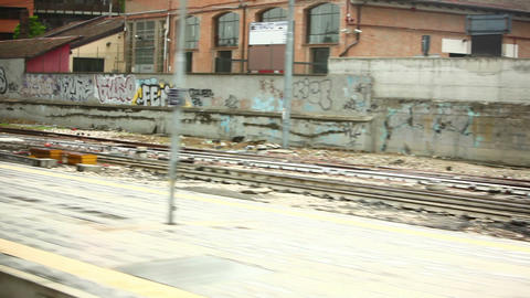 Train tracks and graffiti walls between Rome and Venice Footage
