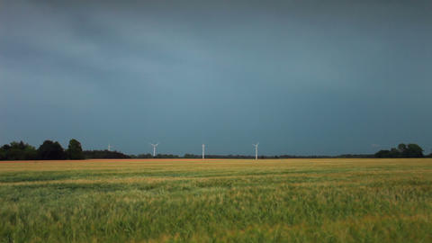 Wide static shot of open field with wind turbines in Copenhagen, Denmark Footage